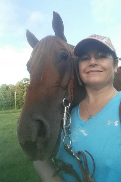 Team member Lois with her horse